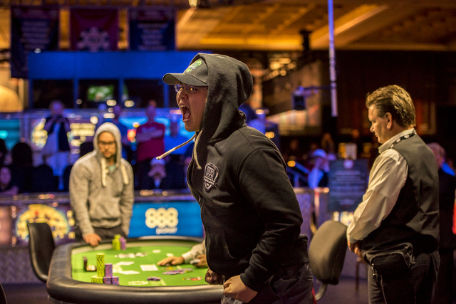 """Perry Shiao yells in excitement after defeating Eric Place in the World Series of Poker's $1,500 buy-in """"Monster Stack"""" tournament held at the Rio Convention Center in Las Vegas on Wedne ..."""