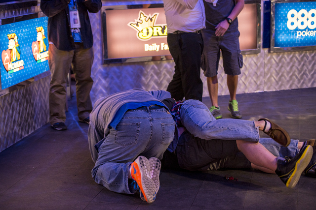 """Perry Shiao is swarmed by friends after defeating Eric Place in the World Series of Poker's $1,500 buy-in """"Monster Stack"""" tournament held at the Rio Convention Center in Las Vegas on Wed ..."""