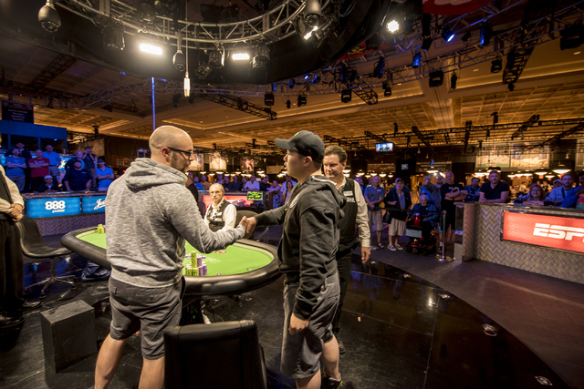 """Eric Place congratulates Perry Shiao on winning the World Series of Poker's $1,500 buy-in """"Monster Stack"""" tournament held at the Rio Convention Center in Las Vegas on Wednesday, June 17, ..."""