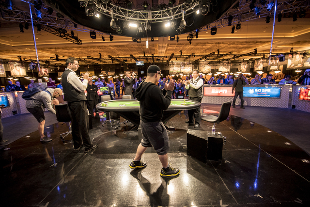 """Perry Shiao celebrates after defeating Eric Place in the World Series of Poker's $1,500 buy-in """"Monster Stack"""" tournament held at the Rio Convention Center in Las Vegas on Wednesday, Jun ..."""