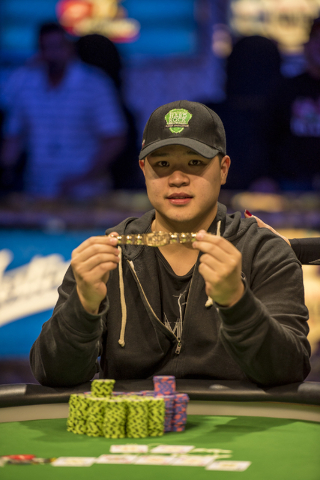 """Perry Shiao poses for photos after defeating Eric Place in the World Series of Poker's $1,500 buy-in """"Monster Stack"""" tournament held at the Rio Convention Center in Las Vegas on Wednesda ..."""