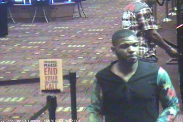 Police are asking for the public's help in finding a man who pointed a gun at security personnel in May at a North Las Vegas business. (Courtesy North Las Vegas Police Department)