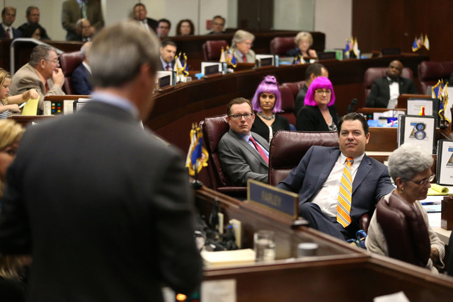 Fellow lawmakers listen as Nevada Sen. Greg Brower, R-Reno, speaks in support of a record $1.1 billion general fund tax package during Senate floor discussion at the Legislative Building in Carson ...