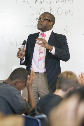 Bentley McDonald, a student teacher, conducts a math lesson at John C. Fremont Middle School in Las Vegas, Friday, June 26, 2015. (Jason Ogulnik/Las Vegas Review-Journal)