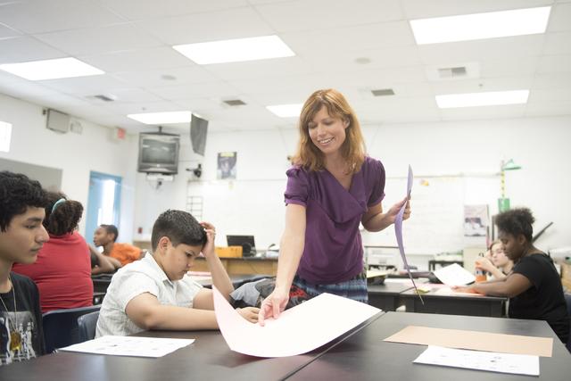 Temple Forsythe, a student teacher, conducts a science lesson at John C. Fremont Middle School in Las Vegas, Friday, June 26, 2015. (Jason Ogulnik/Las Vegas Review-Journal)