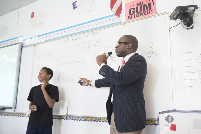 Bentley McDonald, right, a student teacher, and Amarion Moreno, going into 7th grade, work through a math problem in front of the class at John C. Fremont Middle School in Las Vegas, Friday, June  ...