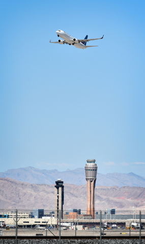 A jet airline takes off from McCarran International Airport under the control of the smaller of the two federal air traffic control towers on Monday, June 8, 2015. The new 352-foot tower originall ...