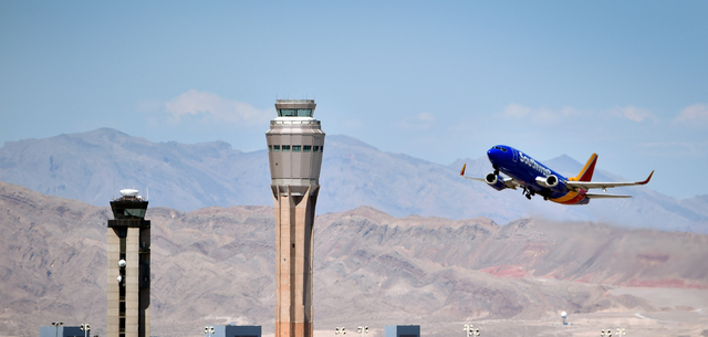 A Southwest Airline passenger jet takes off from McCarran International Airport under the control of the smaller of the two federal air traffic control towers on Monday, June 8, 2015. The new 352- ...