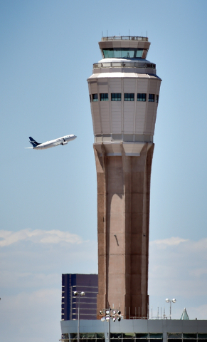 A jet airliner gains altitude as it passes the still under construction air traffic control tower after taking off from  McCarran International Airport on Monday, June 8, 2015. The new 352-foot to ...