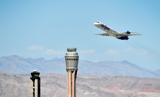 An Allegiant Air passenger jet takes off from McCarran International Airport under the control of the smaller of the two federal air traffic control towers on Monday, June 8, 2015. The new 352-foo ...