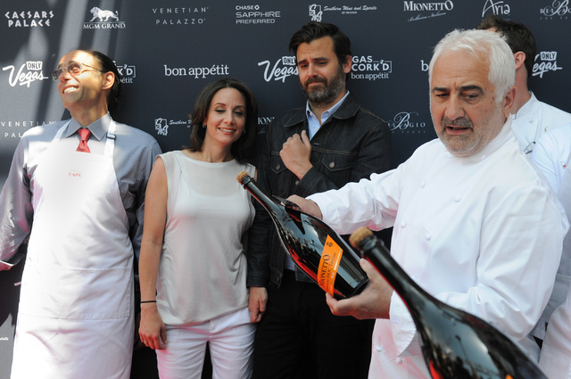 Frank Pellegrino, from left, chef and owner of Rao's restaurant, Pamela Drucker Mann, vice president and publisher at Bon Appétit, and editor Andrew Knowlton, watch as celebrity chef Guy Savoy sa ...