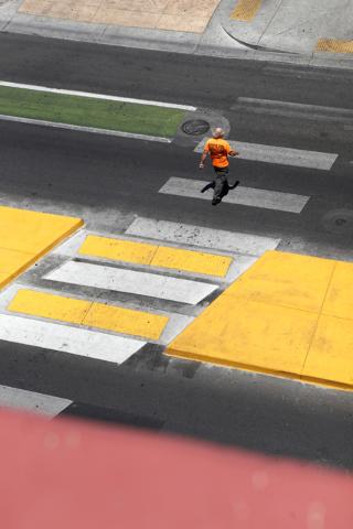 A man walks cross Ogden St. on Tuesday, June 16, 2015, in Las Vegas. Green bike lanes are often more noticeable than others. (James Tensuan/Las Vegas-Review Journal) Follow James Tensuan on Twitte ...