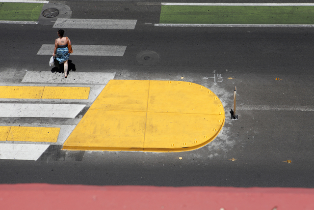 A woman walks across Ogden St. on Tuesday, June 16, 2015, in Las Vegas. Green bike lanes are often more noticeable than others. (James Tensuan/Las Vegas-Review Journal) Follow James Tensuan on Twi ...
