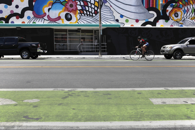 A woman rides her bike down 6th St. on Tuesday, June 16, 2015, in Las Vegas. Green bike lanes are often more noticeable than others. (James Tensuan/Las Vegas-Review Journal) Follow James Tensuan o ...