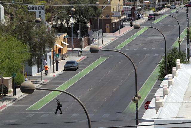 A man walks across Ogden St. on Tuesday, June 16, 2015, in Las Vegas. Green bike lanes are often more noticeable than others. (James Tensuan/Las Vegas-Review Journal) Follow James Tensuan on Twitt ...