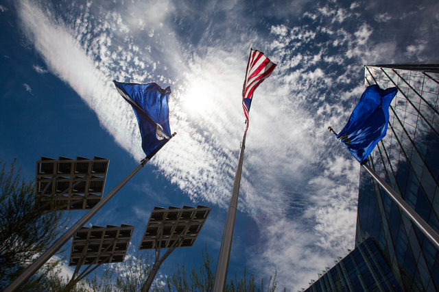 Flags blow in the wind outside of Las Vegas City Hall as temperatures rise to an expected 107 degrees in downtown Las Vegas on Wednesday, June 17, 2015. (Chase Stevens/Las Vegas Review-Journal)