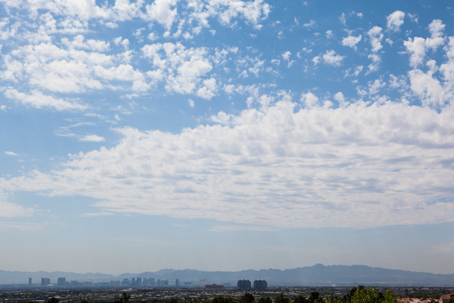 Clouds hover over the Las Vegas Valley as temperatures rise to a forecasted high of 109 degrees on Monday, June 29, 2015. Scattered showers are in the forecast, brought on by a 20% chance of thund ...