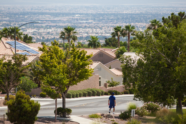 A man walks in the Sun City Summerlin area of Las Vegas as temperatures rise to a forecasted high of 109 degrees on Monday, June 29, 2015. Scattered showers are in the forecast, brought on by a 20 ...