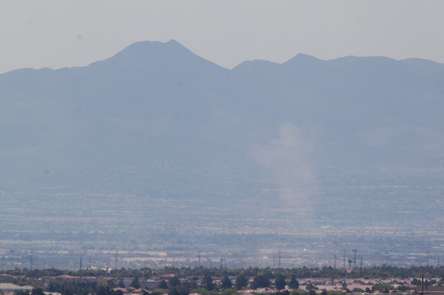 Dust appears to be kicked up in the air in the Las Vegas Valley as temperatures rise to a forecasted high of 109 degrees on Monday, June 29, 2015. Scattered showers are in the forecast, brought on ...