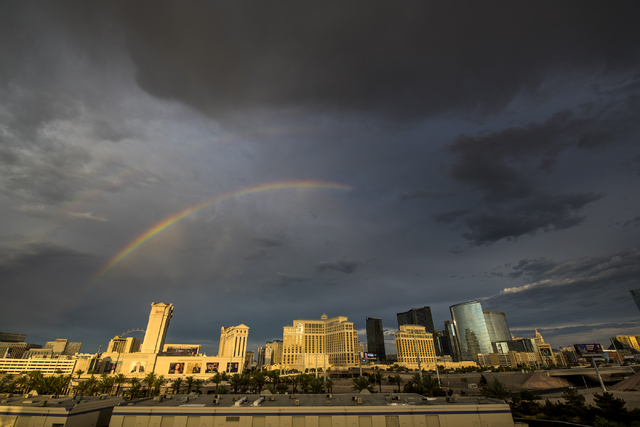 Two rainbows are revealed against rain clouds over the Strip in Las Vegas on Monday, June 29, 2015. (Joshua Dahl/Las Vegas Review-Journal)