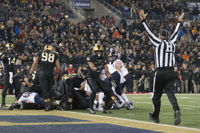 Dec 13, 2014; Baltimore, MD, USA; The linesman signals touchdown after Navy Midshipmen quarterback Keenan Reynolds (19) one yard run during the third quarter of the 115th  annual Army-Navy game at ...
