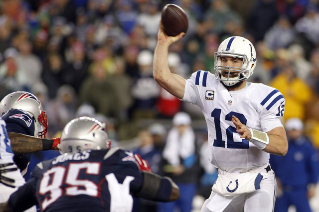 Jan 18, 2015; Foxborough, MA, USA; Indianapolis Colts quarterback Andrew Luck (12) throws a pass during the second quarter against the New England Patriots in the AFC Championship Game at Gillette ...