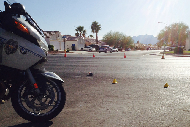 North Las Vegas police investigate at the scene of an accident at Martin Luther King Boulevard and Watercreek Drive on Thursday, June 4, 2015. (Greg Haas/Review-Journal)