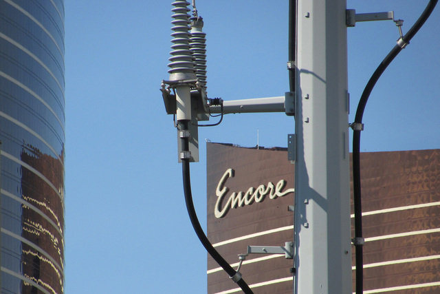 The Encore tower is shown through a power pole that runs along Koval Lane in this Sunday, April 19, 2015, photo. The Wynn tower is at left. (Greg Haas/Las Vegas Review-Journal)