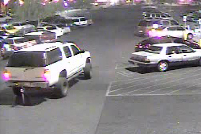 Police are looking for a large, white older model SUV with tinted windows, a lift kit and large, off-road style tires in connection wit a May shooting. (Courtesy)