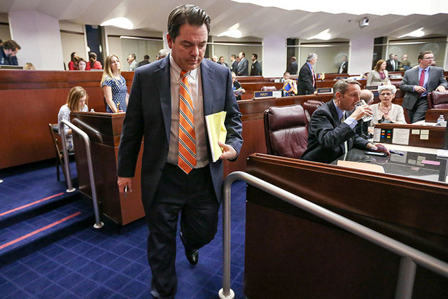 Nevada Senate Majority Leader Michael Roberson, R-Henderson, leaves the Senate chambers during a recess in the final hours of the session at the Legislative Building in Carson City, Nev., on Monda ...