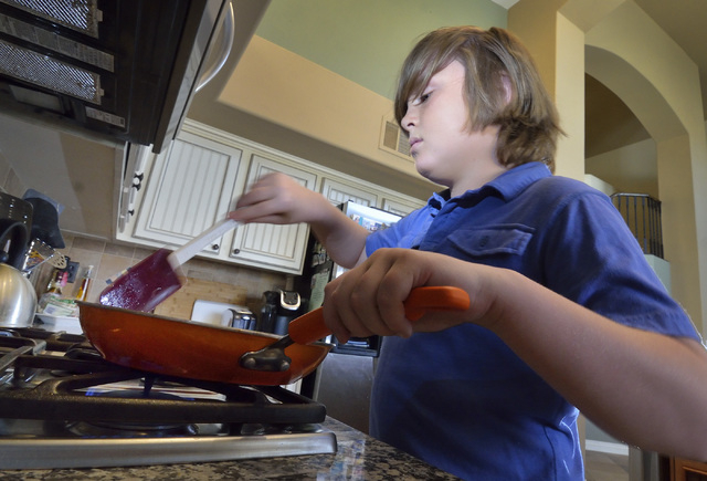 Nine-year-old Jack Newkirk cooks at his home in Henderson on Wednesday, June 24, 2015. He is Nevada's winner in Michelle Obama's Healthy Lunchtime Challenge and will attend a Kids' State Dinner wi ...