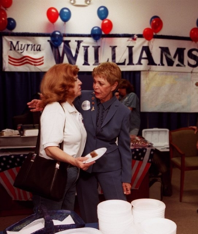 News--Myrna Williams hugs fellow Commissioner Mary Kincaid-Chauncey at William's headquaters, Tuesday, Sept. 3, 2002.--Photo Christine H. Wetzel