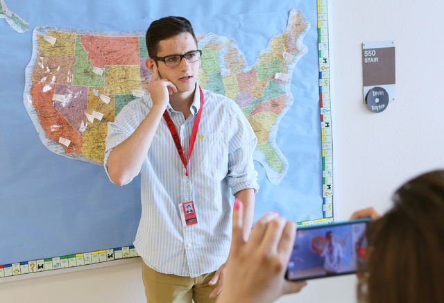 Student Aram Kalikian, center, delivers a mock public service announcement and is recorded by Nicole Karic during a zombie outbreak simulation exercise at Northwest Career & Technical Academy Mond ...
