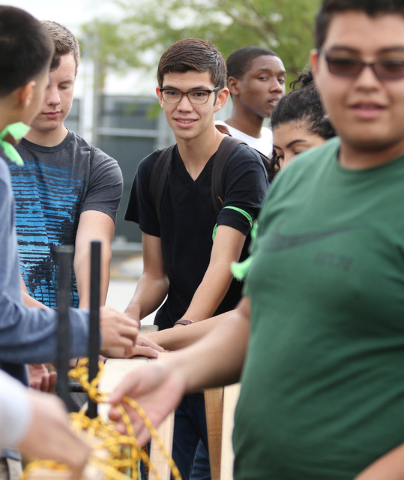 Wayne Boulton, center, works with fellow engineering students to build a bridge during a zombie outbreak simulation exercise at Northwest Career & Technical Academy Monday, May 18, 2015, in Las Ve ...