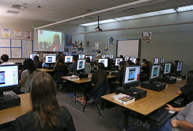 Students watch a school broadcast giving an update on the current zombie outbreak conditions during a mock disaster exercise at Northwest Career & Technical Academy Monday, May 18, 2015, in Las Ve ...