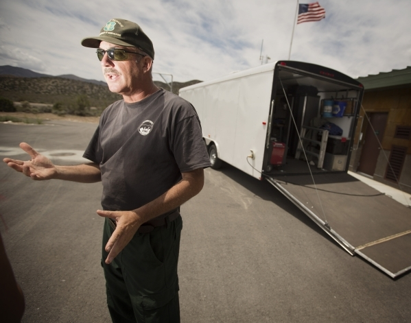 Ray Johnson, a spokesman and prevention patrol officer with the Forest Service, discusses forest fires while standing outside the Kyle Canyon Fire Station near the Spring Mountain Visitor Gateway  ...
