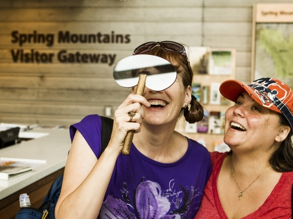 Chris Collier, left, and Wendy Lyons holds polarized glass to view glass panel at the Spring Mountain Visitor Gateway, 2750 Kyle Canyon Road in Mount Charleston, on Thursday, July 9,2015. The 128- ...
