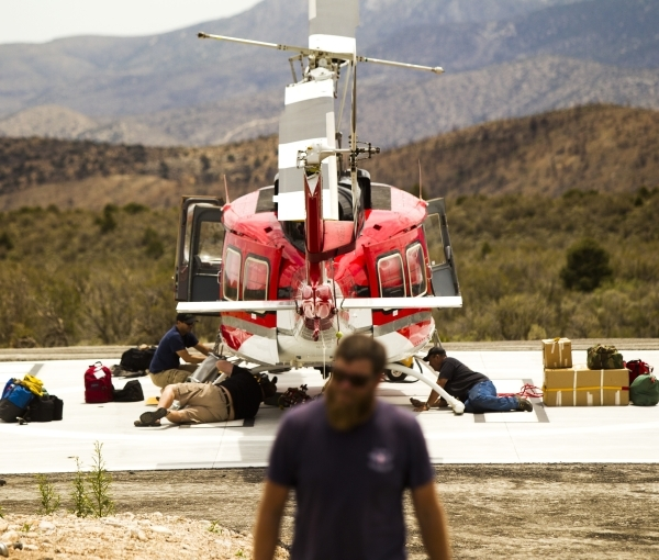 Salmon Heli-rappellers service a helicopter at the Kyle Canyon Fire Station near the Spring Mountain Visitor Gateway on  July  9. Two years ago, the Carpenter 1 fire burned a large swath of land o ...