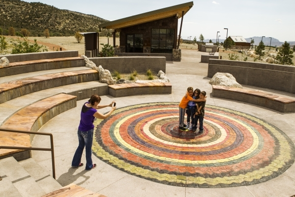 Chris Collier, left, takes photos of her daughter Amanda Collier,center, 8, with Ben Eaton, 9, and Eric Lyons, right,10, at the Spring Mountain Visitor Gateway, amphitheatre, 2750 Kyle Canyon Road ...