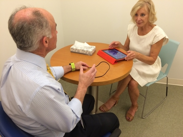 Dr. Charles Bernick, associate medical director of the Lou Ruvo Center for Brain Health, speaks with trial participant Sen. Sandra Tiffany June 18 as she completes a brain test. The center is recr ...