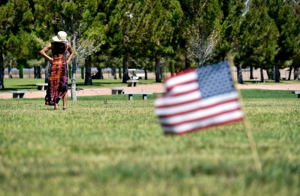 A woman looks over a grave site at the Southern Nevada Veterans Memorial Cemetery on Tuesday, July 14, 2015, in Boulder City. A new state law authorizes the state's two veteran cemeteries in ...