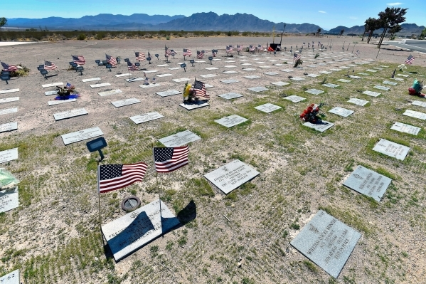 Grave markers are seen in a newly seeded area at the Southern Nevada Veterans Memorial Cemetery on Tuesday in Boulder City. A new state law authorizes the state's two veteran cemeteries in F ...