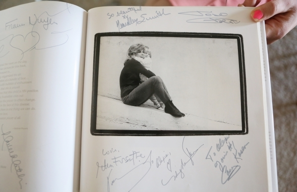 "An autographed page containing a photo of a young Alexis Gibson and actress Stefanie Powers is shown from ""Portraits of Life With Love: An Intimate Collection of Exclusive Photographs of Cele ..."