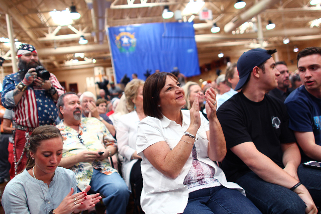 Wisconsin first lady Tonette Walker, center, claps as her husband, Wisconsin Gov. Scott Walker, a Republican presidential candidate, speaks during a campaign stop at Harley-Davidson, 2260 S. Rainb ...