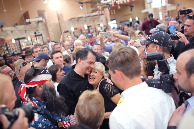 Wisconsin Gov. Scott Walker, a Republican presidential candidate, center left, greets Penelope Colton during a campaign stop at Harley-Davidson, 2260 S. Rainbow Blvd., in Las Vegas on Tuesday, Jul ...