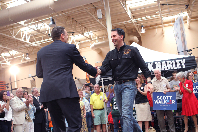 Nevada Attorney General Adam Laxalt, left, greets Wisconsin Gov. Scott Walker, a Republican presidential candidate, during a campaign stop at Harley-Davidson, 2260 S. Rainbow Blvd., in Las Vegas o ...
