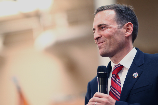 Nevada Attorney General Adam Laxalt introduces Wisconsin Gov. Scott Walker, a Republican presidential candidate, during a campaign stop at Harley-Davidson, 2260 S. Rainbow Blvd., in Las Vegas on T ...
