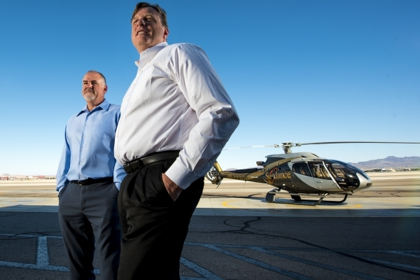 Jay Francis, right, president of Sundance Helicopters, and Mark Schlaefli, director of operations, pose for a photo at Sundance Helicopters in Las Vegas on Wednesday, July 15, 2015. (Joshua Dahl/L ...