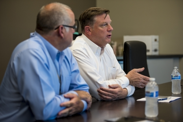 Jay Francis, right, president of Sundance Helicopters, speaks next to Mark Schlaefli, director of operations, during an interview at Sundance Helicopters in Las Vegas on Wednesday, July 15, 2015.  ...