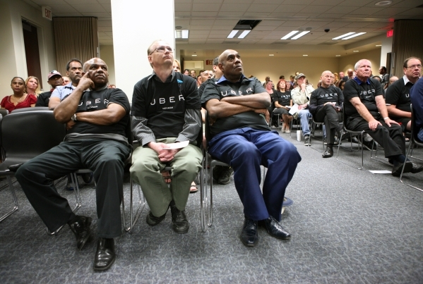 Uber supporters wear matching shirts as they attend a legislative hearing March 30 at the Grant Sawyer Building in Las Vegas. Southern Nevada taxi drivers and Uber supporters were among those who  ...